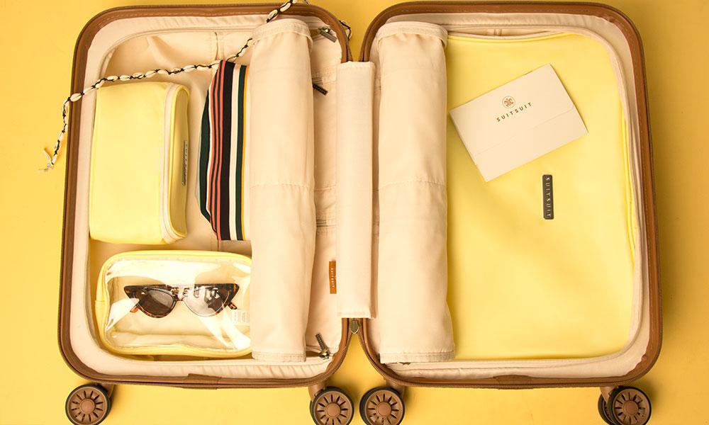 blog-op-reis-vakantie-meenemen-koffer-packing-cubes-geel