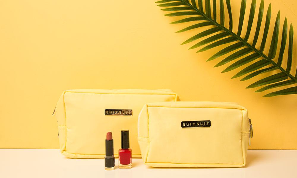 blog-vakantie-toilettas-geel-suitsuit